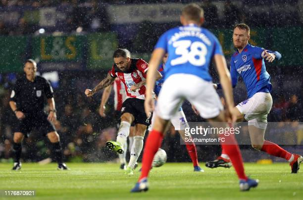 Danny Ings of Southapton scores his team's first goal during the Carabao Cup Third Round match between Portsmouth FC and Southampton FC at Fratton...