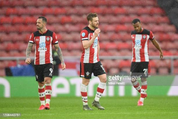 Danny Ings Ryan Bertrand and Stuart Armstrong of Southampton look djected during the Premier League match between Southampton FC and Burnley FC at St...