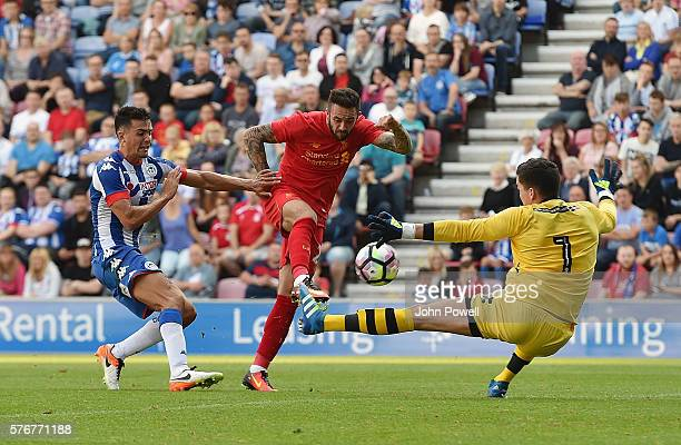Danny Ings scoring the opening goal of Liverpool during the PreSeason Friendly match between Wigan Athletic and Liverpool at JJB Stadium on July 17...
