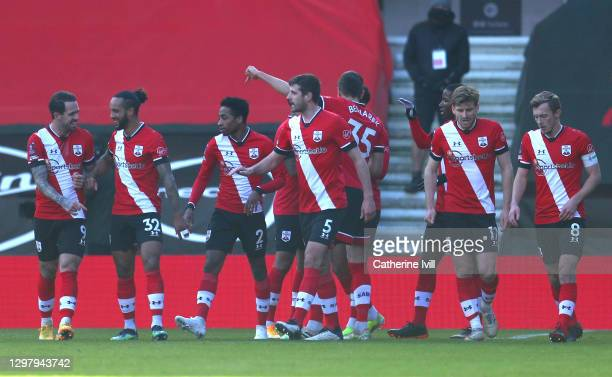 Danny Ings, Theo Walcott, Kyle Walker-Peters, Jack Stephens, Stuart Armstrong and James Ward-Prowse of Southampton celebrate their sides first goal,...