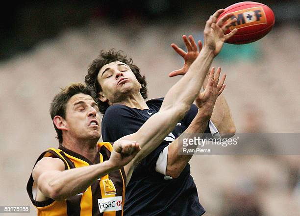 Danny Jacobs for the Hawks spoils Troy Longmuir for the Blues during the round seventeen AFL match between the Hawthorn Hawks and the Carlton Blues...
