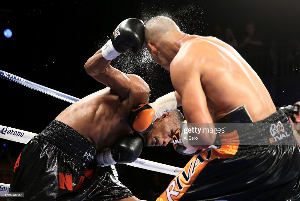 Danny Jacobs punches Giovanni Lorenzo during their Junior Middleweight fight at Best Buy Theater on August 19, 2013 in New York City.