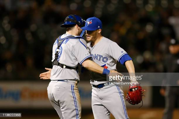 Danny Jansen and Ken Giles of the Toronto Blue Jays celebrate after a win against the Oakland Athletics at OaklandAlameda County Coliseum on April 19...