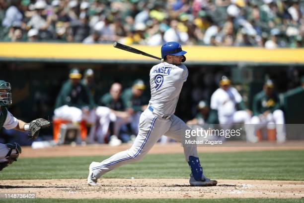 Danny Jansen of the Toronto Blue Jays bats during the game against the Oakland Athletics at the OaklandAlameda County Coliseum on April 21 2019 in...