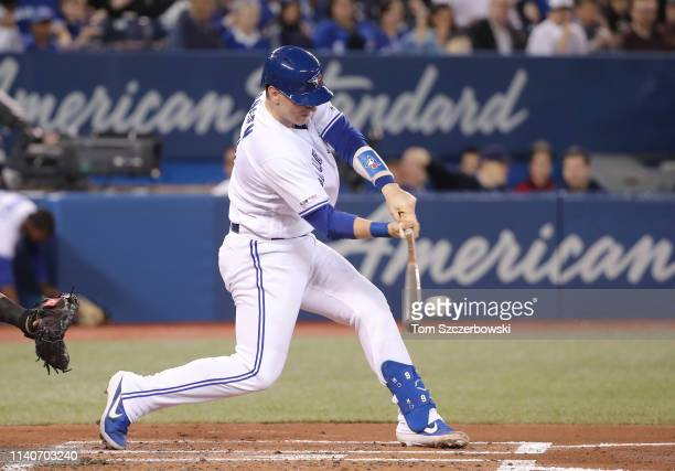 Danny Jansen of the Toronto Blue Jays bats in the second inning during MLB game action against the Baltimore Orioles at Rogers Centre on April 2 2019...