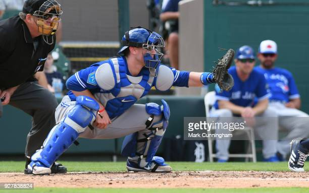 Danny Jansen of the Toronto Blue Jays catches during the Spring Training game against the Detroit Tigers at Publix Field at Joker Marchant Stadium on...