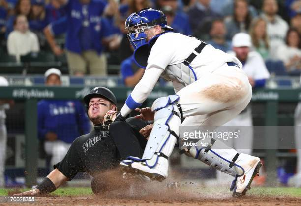 Danny Jansen of the Toronto Blue Jays forces out Daniel Vogelbach of the Seattle Mariners at home in the eighth inning during their game at TMobile...