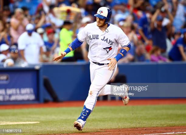 Danny Jansen of the Toronto Blue Jays hits a home run in the fourth inning during a MLB game against the Boston Red Sox at Rogers Centre on July 03...