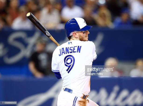 Danny Jansen of the Toronto Blue Jays hits a single in the fifth inning of a MLB game against the Kansas City Royals at Rogers Centre on June 28 2019...