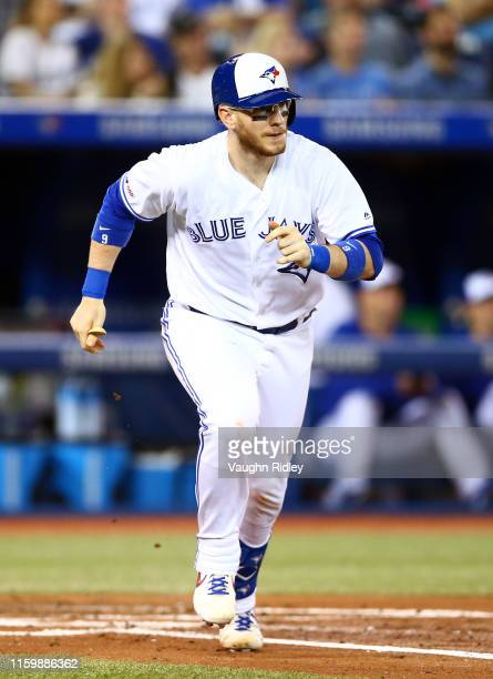 Danny Jansen of the Toronto Blue Jays hits a single in the third inning of a MLB game against the Kansas City Royals at Rogers Centre on June 28 2019...