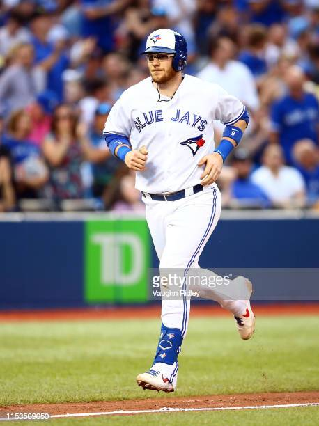 Danny Jansen of the Toronto Blue Jays hits a two run home run in the fourth inning during a MLB game against the Boston Red Sox at Rogers Centre on...