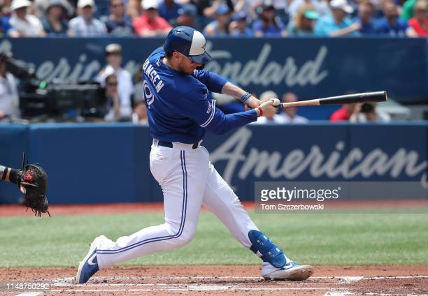 Danny Jansen of the Toronto Blue Jays hits an RBI double in the second inning during MLB game action against the Arizona Diamondbacks at Rogers...