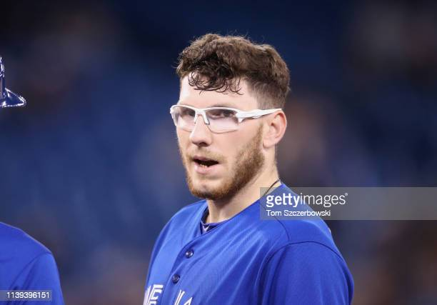 Danny Jansen of the Toronto Blue Jays looks on from first base after hitting a single in the eighth inning during MLB game action against the Detroit...