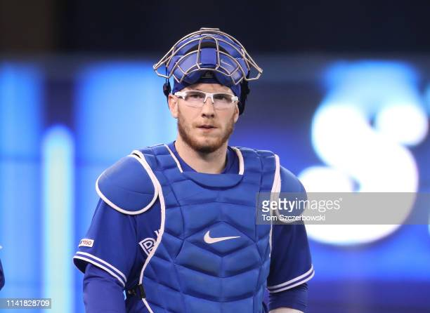 Danny Jansen of the Toronto Blue Jays makes his way from the bullpen to the dugout before the start of MLB game action against the Detroit Tigers at...