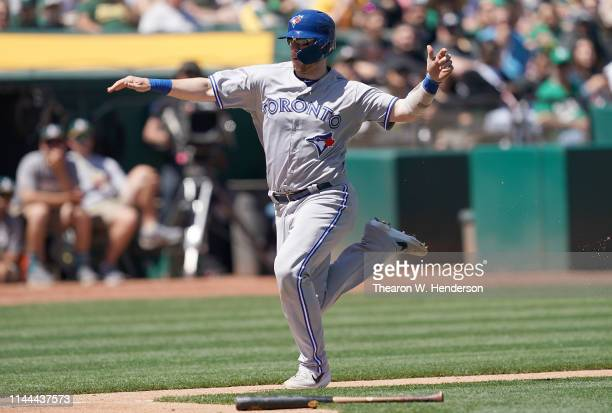 Danny Jansen of the Toronto Blue Jays races towards home plate against the Oakland Athletics in the top of the third inning of a Major League...
