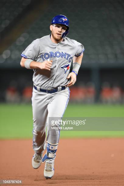 Danny Jansen of the Toronto Blue Jays rounds the bases after hitting a home run during a baseball game against the Baltimore Orioles at Oriole Park...