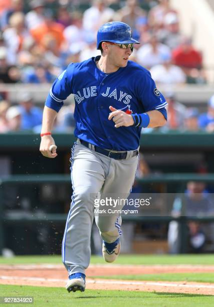 Danny Jansen of the Toronto Blue Jays runs to first base during the Spring Training game against the Detroit Tigers at Publix Field at Joker Marchant...