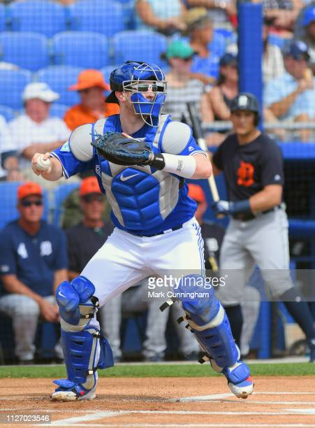 Danny Jansen of the Toronto Blue Jays throws a baseball during the Spring Training game against the Detroit Tigers at Dunedin Stadium on February 23...