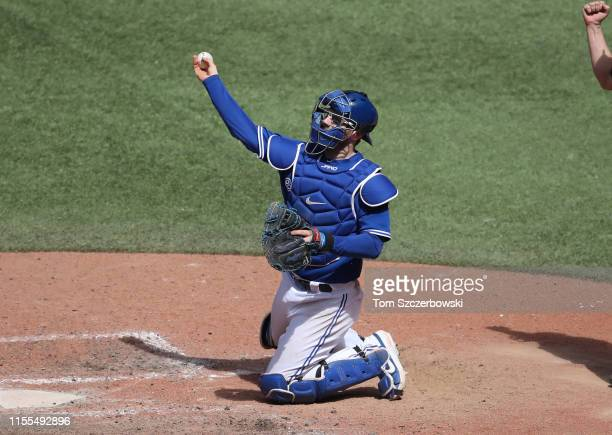 Danny Jansen of the Toronto Blue Jays throws the ball to third base following a strikeout during MLB game action against the Arizona Diamondbacks at...