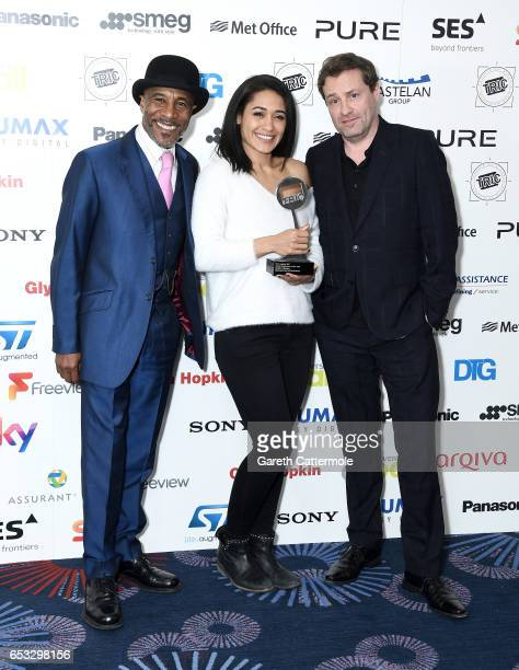 "Danny John-Jules, Josephine Jobert and guest with the award for Crime Programme of the Year for ""Death in Paradise"" during the TRIC Awards 2017 at..."