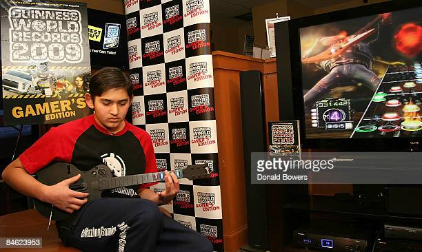 Danny Johnson breaks the Guinness World Record for highest score on a single song on Guitar Hero III Legends of Rock at Best Buy on February 4 2009...