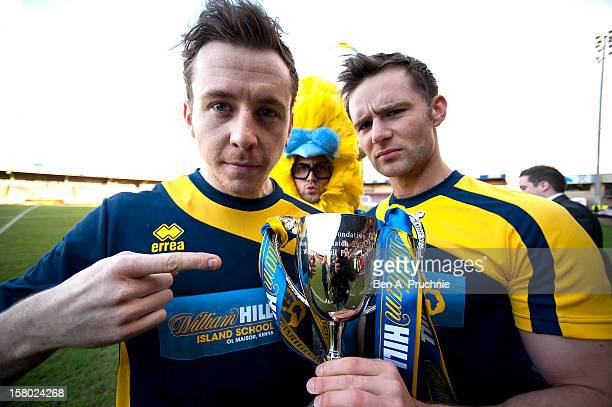 Danny Jones and Harry Judd participate in the William Hill Foundation Cup on December 9 2012 in Birmingham England All proceeds from the game go to...