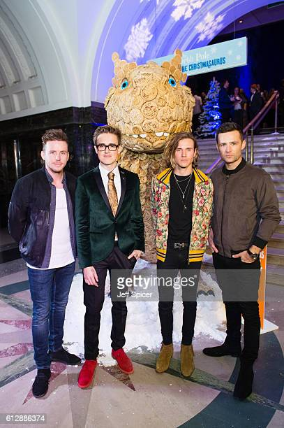 Danny Jones Tom Fletcher Dougie Poynter and Harry Judd from McFly meet the 'Giant Crumpet Christmasaurus' Warburtons created a 'Giant Crumpet...