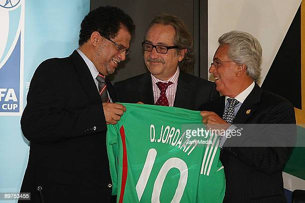 Danny Jordaan, of the Local Organising Committee chief executive for the 2010 World Cup, Decio de Maria and Justino Compean during a press conference...
