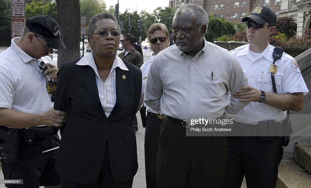 Danny K. Davis, D-Ill, and Donna M. Christensen, U.S. Virgin Islands Delegate to Congress, are arrested on the steps of the Sudanese Embassy. They were there to protest to the crisis in the Darfur region of Sudan and to call for an increased American presence in the resolution of the growing genocide.