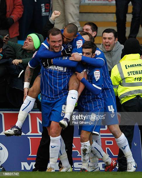 Danny Kedwell of Gillingham celebrates with teammates after scoring the opening goal during the FA Cup Third Round match between Gillingham and Stoke...