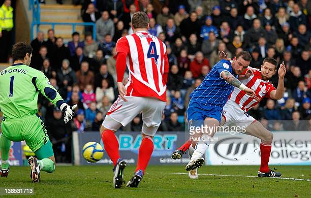 Danny Kedwell of Gillingham scores the opening goal during the FA Cup Third Round match between Gillingham and Stoke City at Priestfield Stadium on...