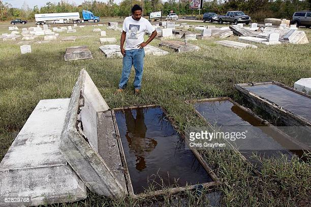 Danny Kelley looks over the graves of his mom and dad where the caskets floated away in the storm surge associated with Hurricane Ike September 15...