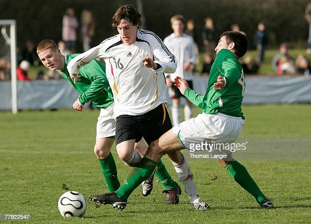 Danny Kelly of Ireland and Sebastian Rudy of Germany battle for the ball during the U18 international friendly match between Germany and Ireland at...