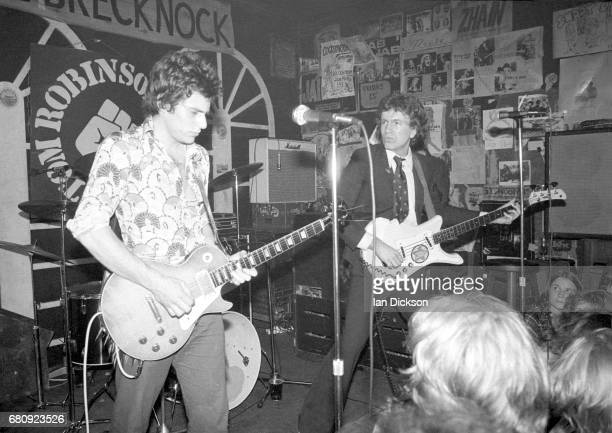 Danny Kustow and Tom Robinson of the Tom Robinson Band performing on stage at The Brecknock London 30th August 1977
