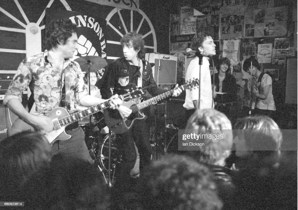 Danny Kustow (left) and Tom Robinson (centre) of the Tom Robinson Band performing on stage with Mick Jones of The Clash (second left) and Glen Matlock of the Rich Kids (far right) at The Brecknock, London, 30th August 1977.