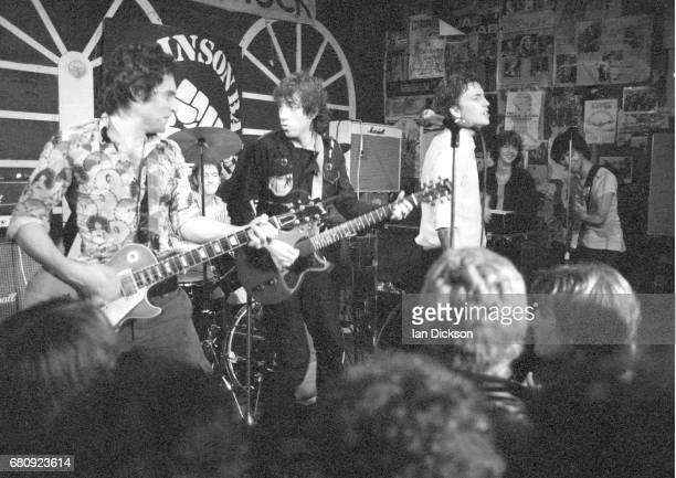 Danny Kustow and Tom Robinson of the Tom Robinson Band performing on stage with Mick Jones of The Clash and Glen Matlock of the Rich Kids at The...