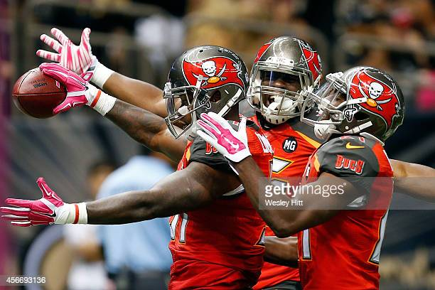 Danny Lansanah of the Tampa Bay Buccaneers celebrates a touchdown during the third quarter of a game against the New Orleans Saints at the...