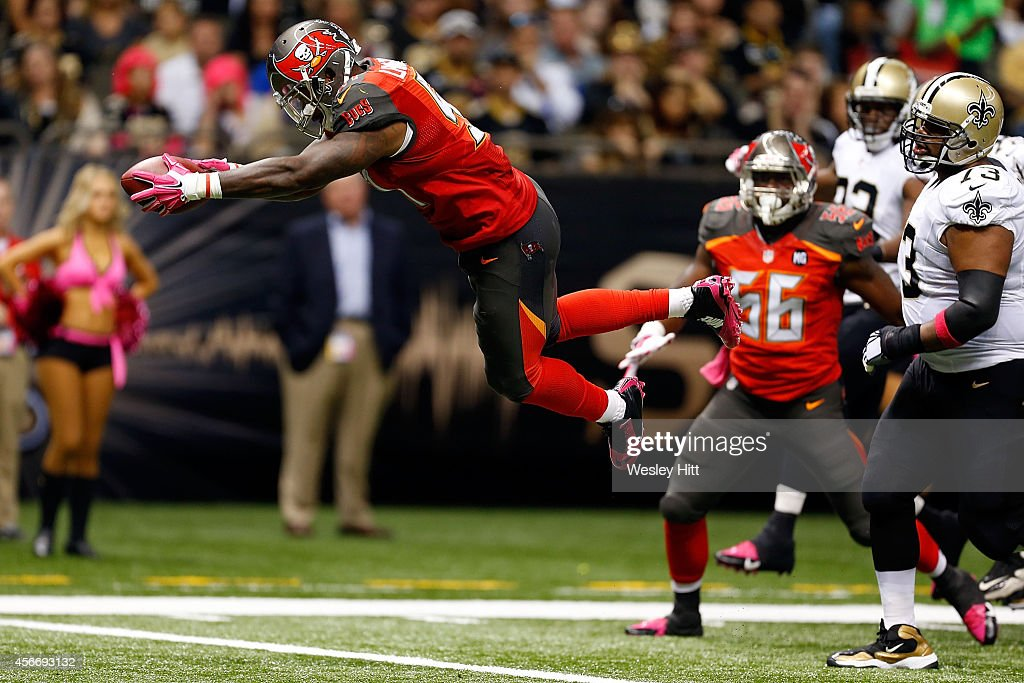 Danny Lansanah #51 of the Tampa Bay Buccaneers dives into the endzone following an interception during the third quarter of a game against the New Orleans Saints at the Mercedes-Benz Superdome on October 5, 2014 in New Orleans, Louisiana.
