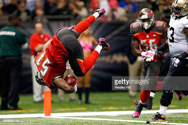 Danny Lansanah of the Tampa Bay Buccaneers dives into the endzone following an interception during the third quarter of a game against the New...