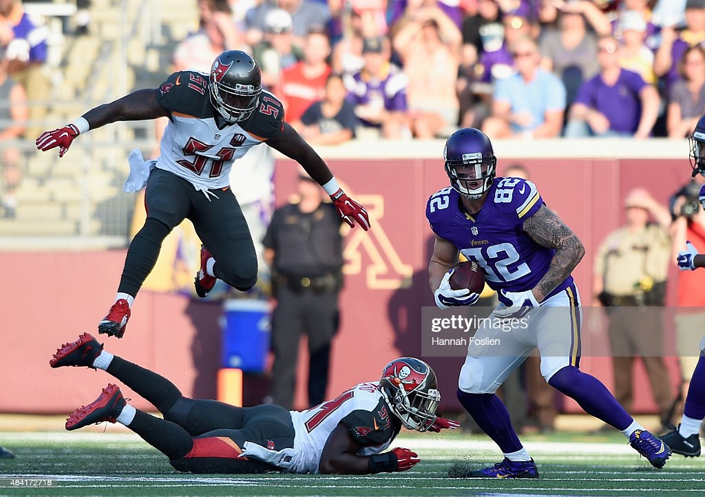 Danny Lansanah #51 of the Tampa Bay Buccaneers jumps over teammate Lavonte David #54 as Kyle Rudolph #82 of the Minnesota Vikings carries the ball during the first quarter of the preseason game on August 15, 2015 at TCF Bank Stadium in Minneapolis, Minnesota.