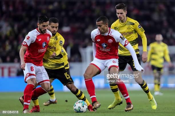 Danny Latza of FSV Mainz 05 Jeremy Toljan of Borussia Dortmund Julian Weigl of Borussia Dortmund and Robin Quaison of FSV Mainz 05 battle for the...