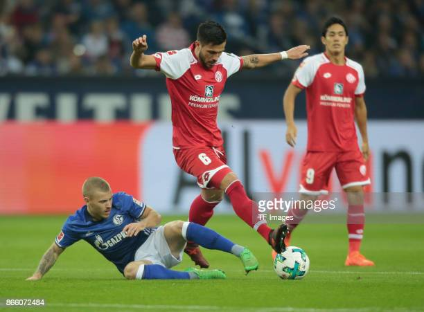 Danny Latza of Mainz and Max Meyer of Schalke battle for the ball during the Bundesliga match between FC Schalke 04 and 1 FSV Mainz 05 at...