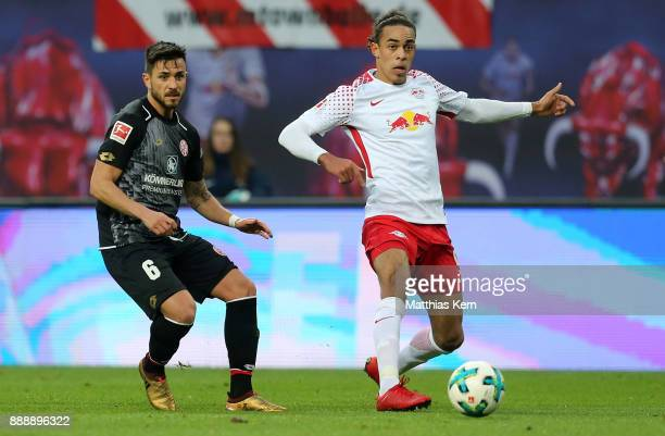 Danny Latza of Mainz battles for the ball with Yussuf Poulsen of Leipzig during the Bundesliga match between RB Leipzig and 1FSV Mainz 05 at Red Bull...