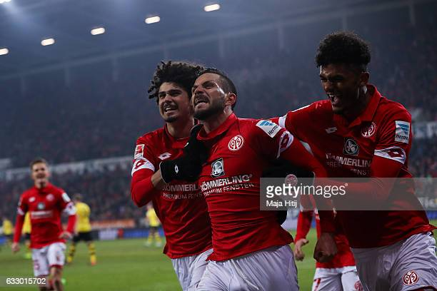 Danny Latza of Mainz celebrates with Andre Ramalho and Aaron Seydel after he scores the equalizing goal to make it 11 during the Bundesliga match...
