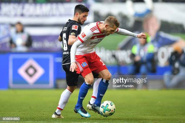 Danny Latza of Mainz fights for the ball with Aaron Hunt of Hamburg during the Bundesliga match between Hamburger SV and 1 FSV Mainz 05 at...