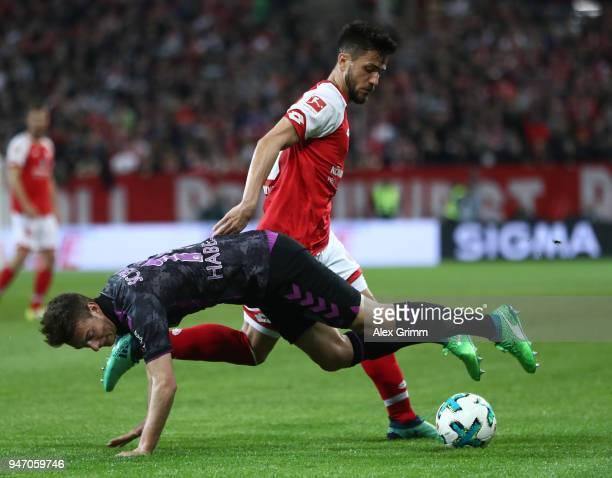 Danny Latza of Mainz is challenged by Janik Haberer of Freiburg during the Bundesliga match between 1 FSV Mainz 05 and SportClub Freiburg at Opel...