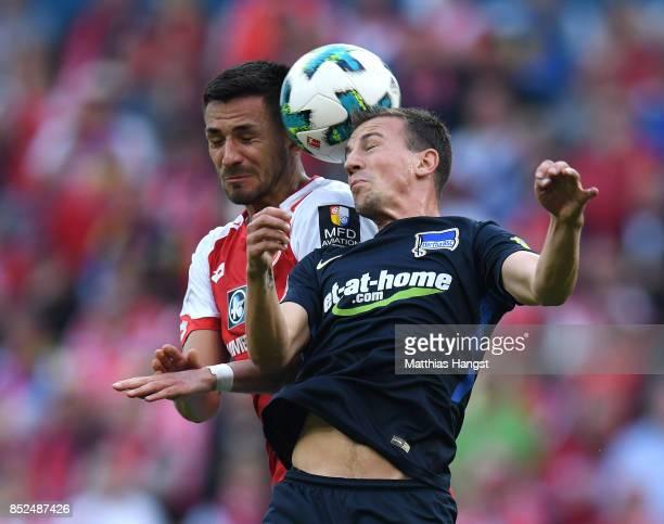 Danny Latza of Mainz jumps for a header with Vladimir Darida of Berlin during the Bundesliga match between 1 FSV Mainz 05 and Hertha BSC at Opel...
