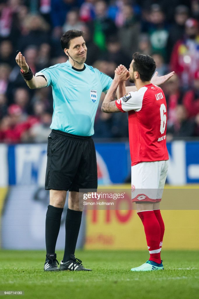 Danny Latza of Mainz reacts as referee Manuel Graefe gestures during the Bundesliga match between 1. FSV Mainz 05 and Borussia Moenchengladbach at Opel Arena on April 1, 2018 in Mainz, Germany.