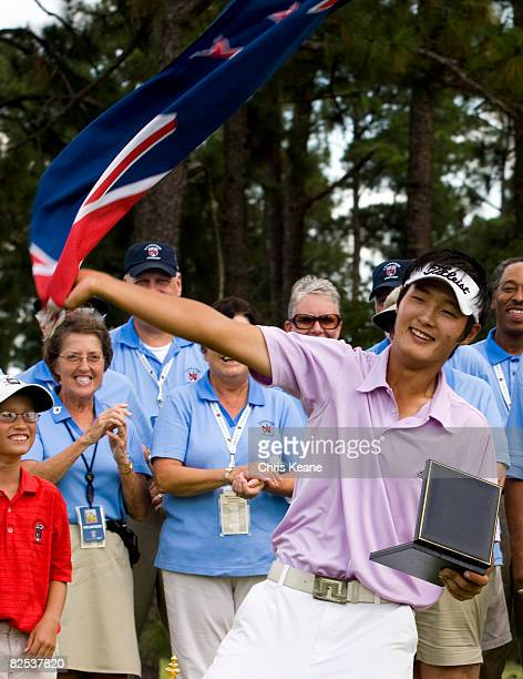 Danny Lee of New Zealand celebrates by waving a New Zealand flag after winning the US Amateur Championship at Pinehurst Resort Country Club August 24...