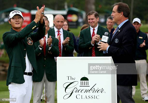 Danny Lee of New Zealand claps as Jim Nance of CBS speaks after winning on the second hole of a sudden death playoff at the Greenbrier Classic held...